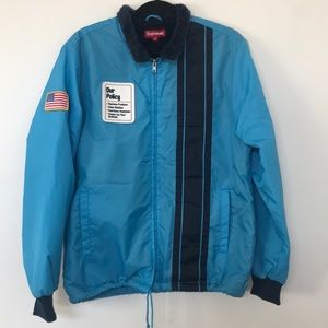 Teal pit stop jacket with faux fur lining